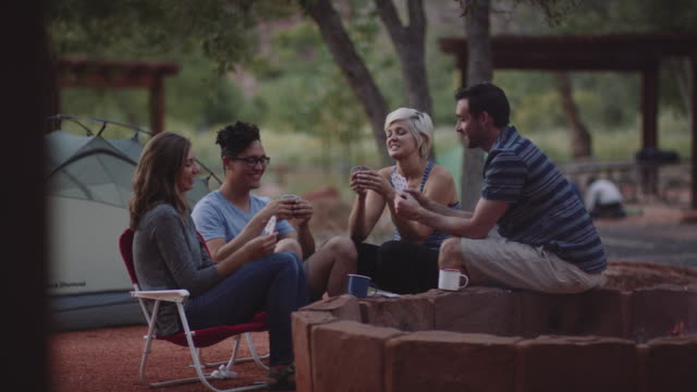 4K UHD: Playing Cards Next to a Campfire
