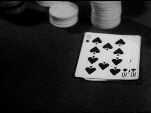 playing cards on table next to chips, two tens showing, male fingers separating cards revealing two of diamonds & two jacks face cards. two pair,... - hand of cards stock videos & royalty-free footage