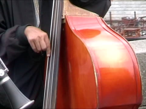 playing cello and clarinet in prague - charles bridge stock videos & royalty-free footage