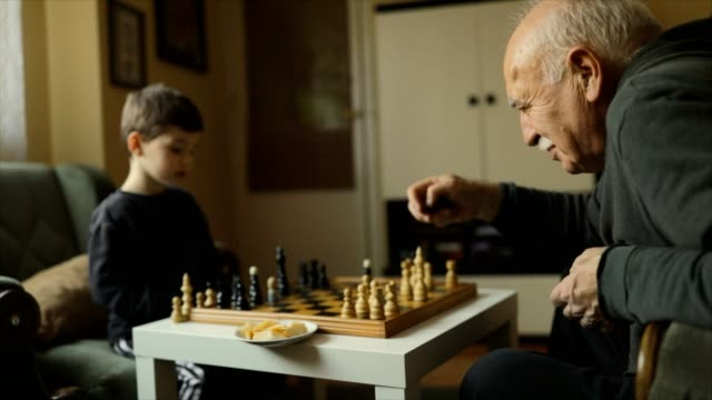 playing chess with grandfather - grandfather stock videos & royalty-free footage