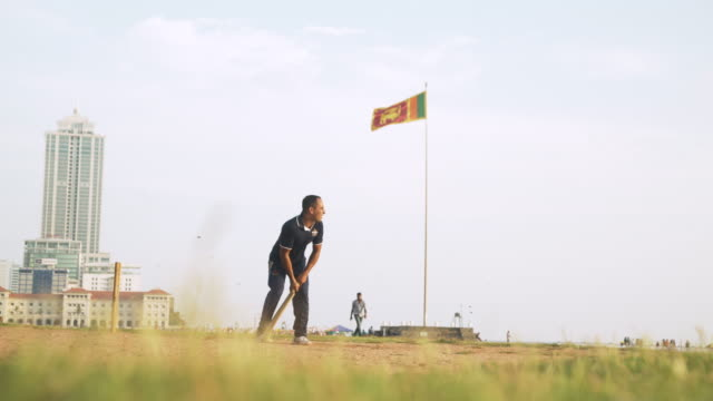playing cricket at colombo with sri lankan flag. iconic image of galle face - sri lankan flag stock videos & royalty-free footage