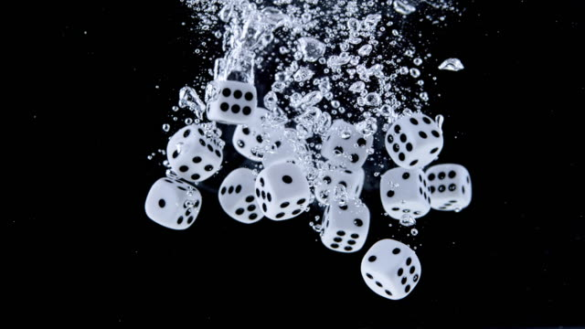 slo mo ld playing dice falling into the water - dice stock videos & royalty-free footage