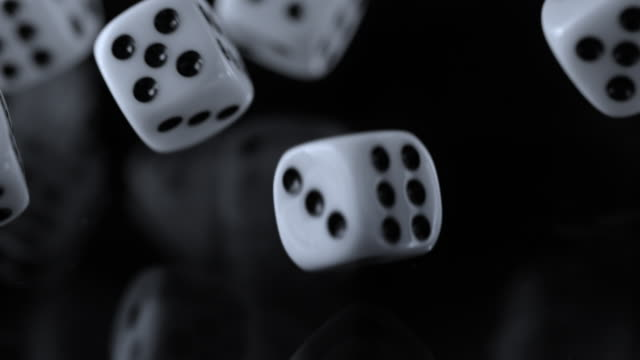 slo mo ld playing dice falling onto a black surface and rolling - dice stock videos & royalty-free footage