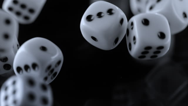 slo mo ld playing dice rolling on black surface - rolling stock videos & royalty-free footage