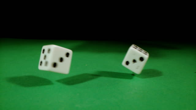 slo mo playing dice spinning on a gambling table - dice stock videos & royalty-free footage