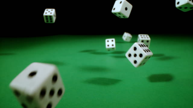 slo mo playing dices falling on a gambling table - dice stock videos & royalty-free footage