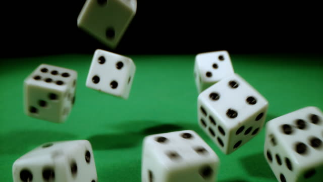 slo mo playing dices on a gambling table - risk stock videos & royalty-free footage