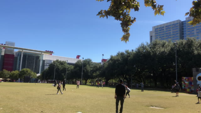 playing football in discovery green, houston, texas - family with two children stock videos & royalty-free footage