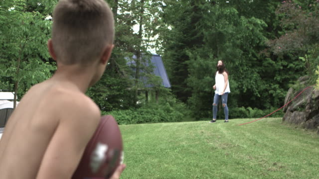 playing football party big family outdoor - gazebo stock videos & royalty-free footage