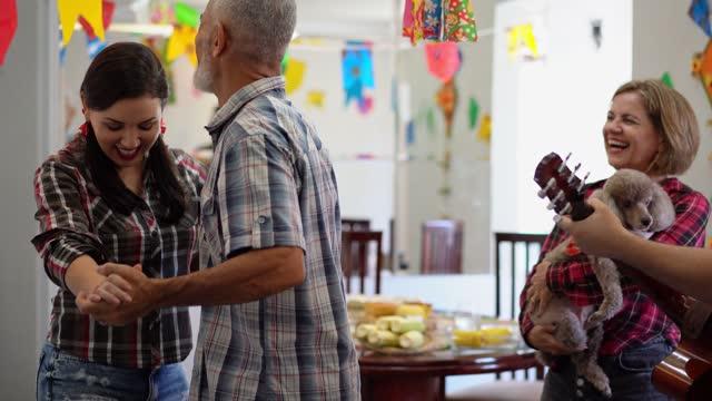 vídeos de stock e filmes b-roll de playing guitar and dancing at the festa junina - dança quadrada