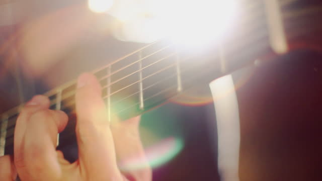 playing guitar. close up on hands - musical instrument string stock videos and b-roll footage