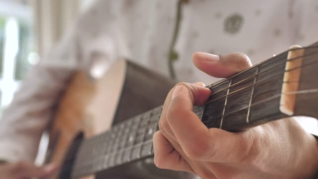 playing guitar close up - guitarist stock videos & royalty-free footage