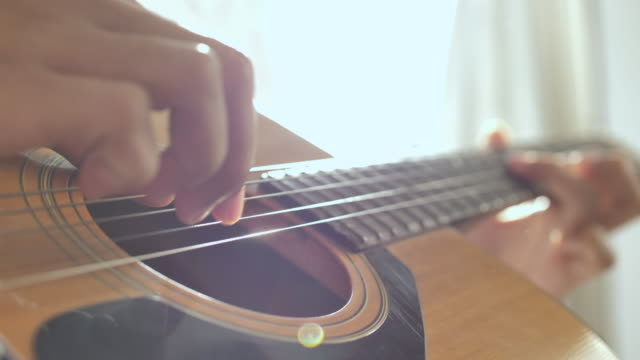 playing guitar, close up - string stock videos and b-roll footage
