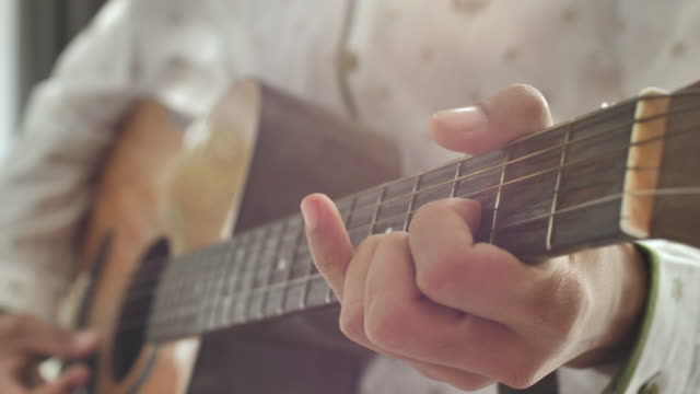playing guitar - guitar stock videos & royalty-free footage