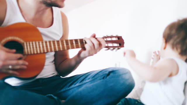 playing guitar with my dad - baby boys stock videos and b-roll footage