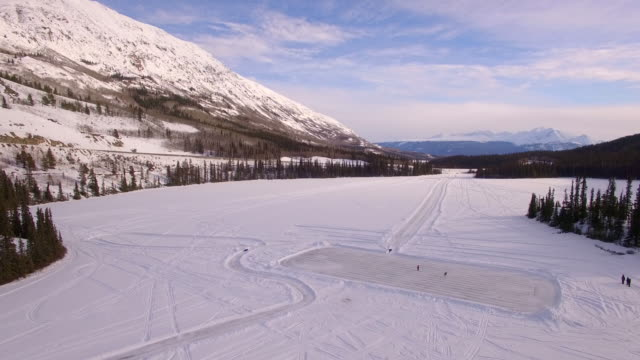 playing hockey on frozen lake - whitehorse stock videos and b-roll footage