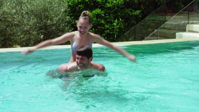 playing in pool - 12 13 år bildbanksvideor och videomaterial från bakom kulisserna