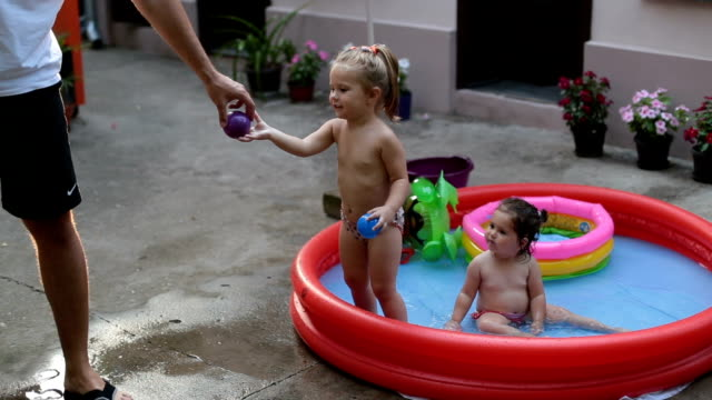 playing in pool - baby girls stock videos & royalty-free footage