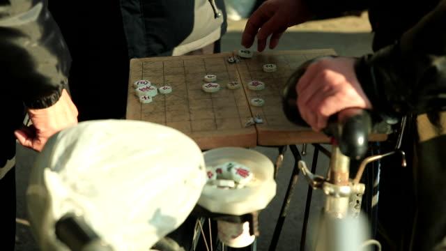 playing janggi (chinese chess) at tapgol park / jongno-gu, seoul, south korea - board game stock videos & royalty-free footage