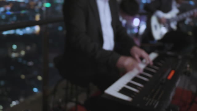 playing keyboard at party - pianist stock videos & royalty-free footage