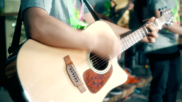 playing musical guitar on the street - performance stock videos & royalty-free footage