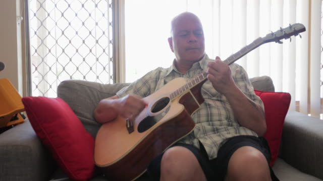 playing my guitar - pacific islander stock videos & royalty-free footage