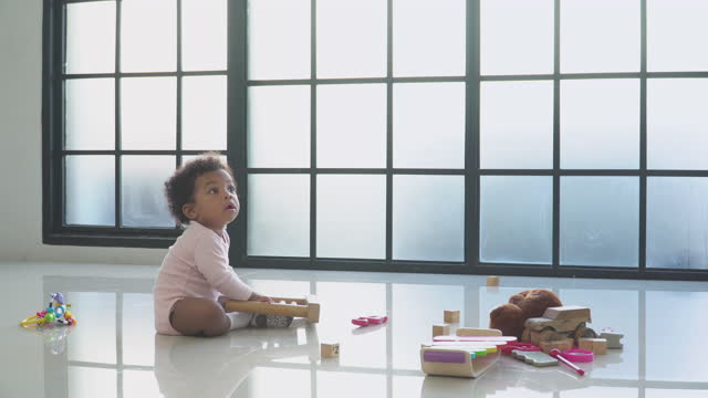 playing of a sibling, african baby girl play wooden math toy with innocence feeling with a little sister in the living room, concept of preschool, childhood - 2 3 years stock videos & royalty-free footage