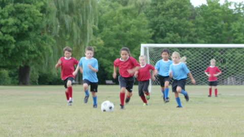 playing on a kids soccer team - sporting term stock videos & royalty-free footage