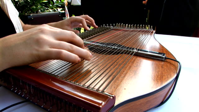 hd: playing on a zither - harp stock videos & royalty-free footage