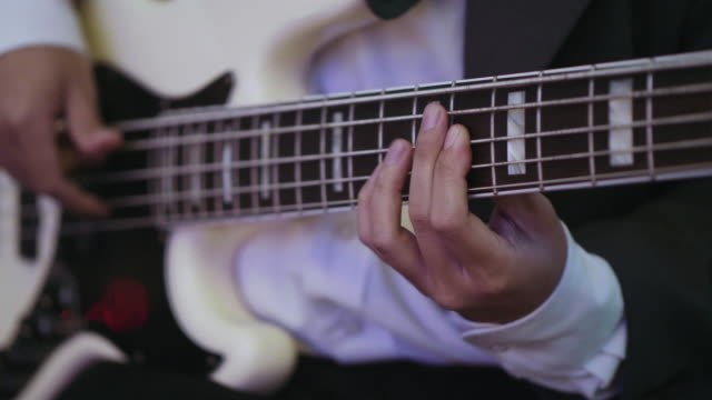 playing on electrical bass guitar (parties - brief) - bass guitar stock videos & royalty-free footage