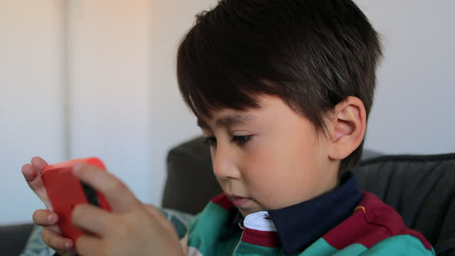 playing on my phone - one boy only stock videos & royalty-free footage