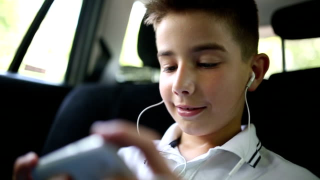 Playing on smart phone in the car