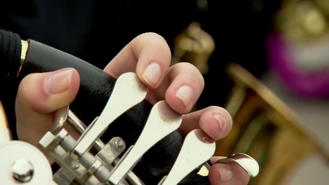 playing on wind instrument - orchester stock-videos und b-roll-filmmaterial