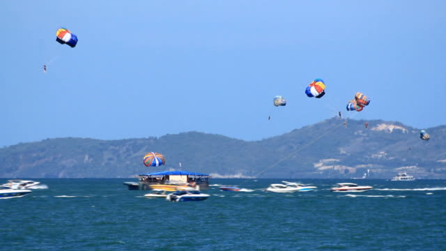 playing parasailing on the sea - pattaya stock videos & royalty-free footage
