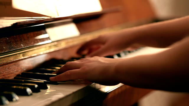 playing piano pan shot - performing arts event stock videos & royalty-free footage