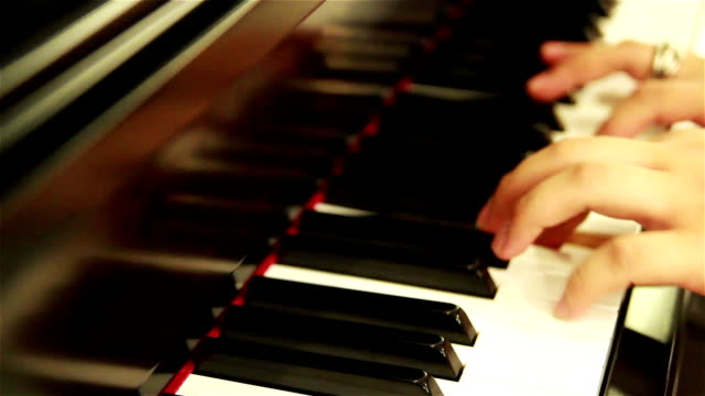 playing piano - human finger stock videos and b-roll footage