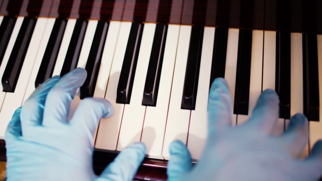 playing piano wearing gloves - performing arts event stock videos & royalty-free footage