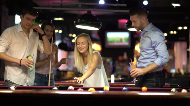 playing pool billiard with friends