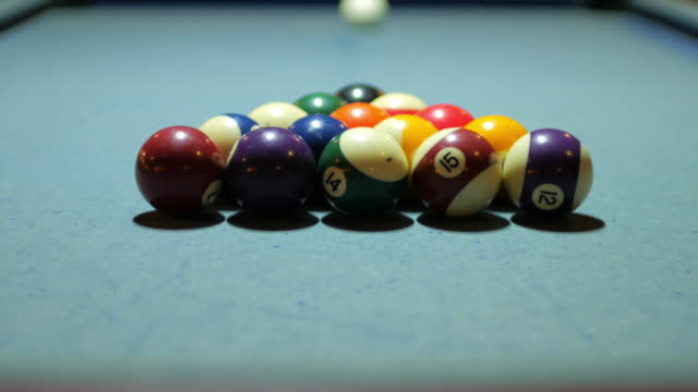 playing pool game , start shot of pool game on pool table and balls making , 4k(uhd) - pool table stock videos & royalty-free footage
