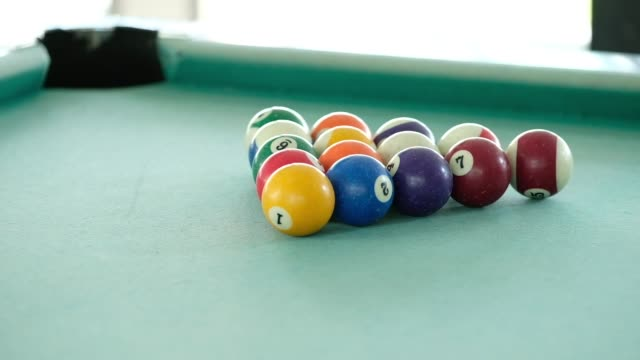 Playing snooker ball on pool table.breaking spheres