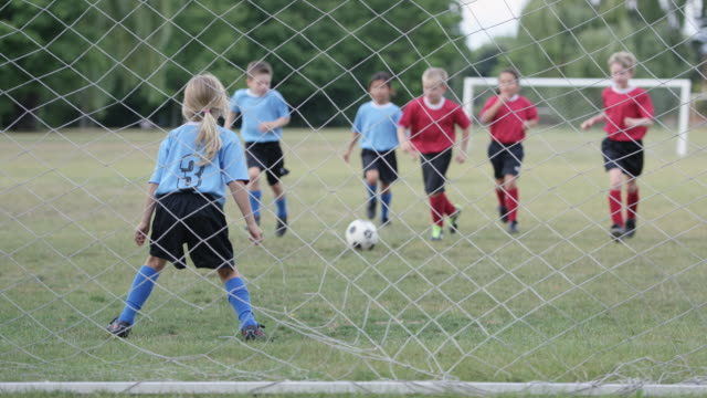 playing soccer on a team - kicking stock videos & royalty-free footage