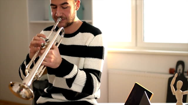 playing some music - trumpet stock videos and b-roll footage
