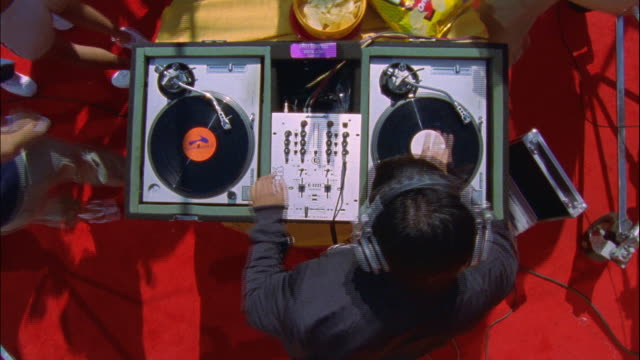 vídeos de stock e filmes b-roll de ms dj playing song on dj mixer for all dancing people  / portland, or, united states - dj