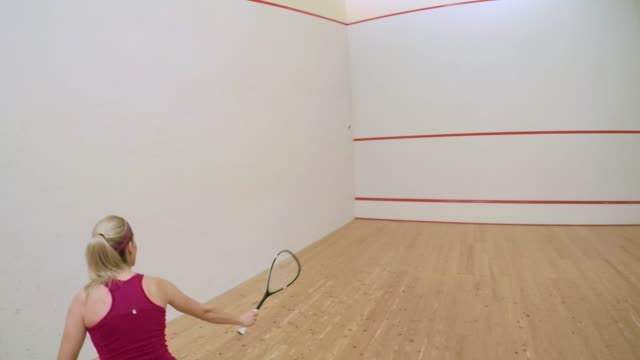 pov playing squash with a female player - squash sport stock videos & royalty-free footage