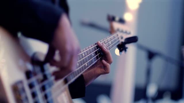 playing the bass guitar, close up - bass guitar stock videos & royalty-free footage