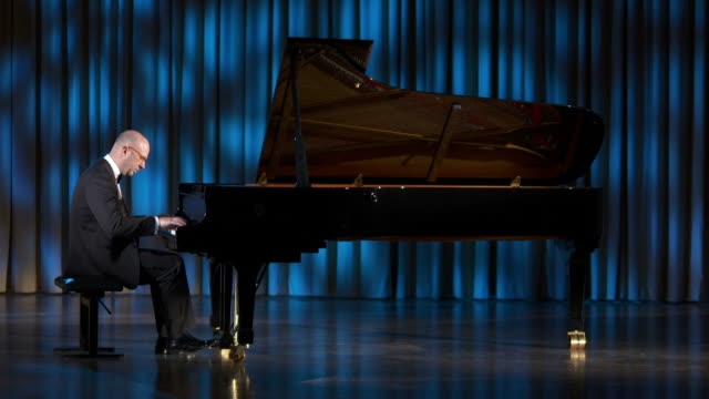 hd dolly: playing the grand piano during classical concert - concert hall stock videos and b-roll footage