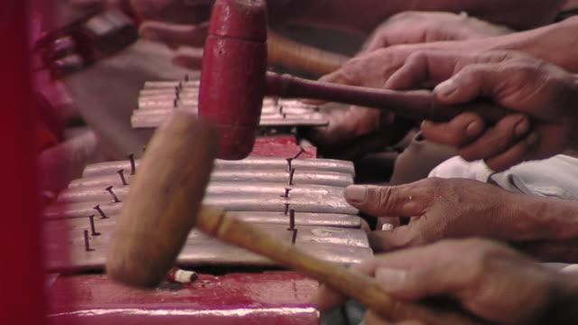 cu playing traditional instrument / surabaya, east java, indonesia  - surabaya stock videos & royalty-free footage