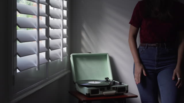 playing vinyl, tapping to music. - jeans stock videos & royalty-free footage