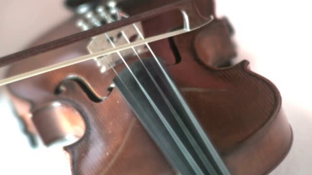 playing violin in slow motion - violin stock videos & royalty-free footage