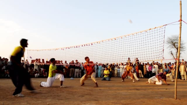 playing volley ball in the village festival - punjab pakistan stock videos & royalty-free footage